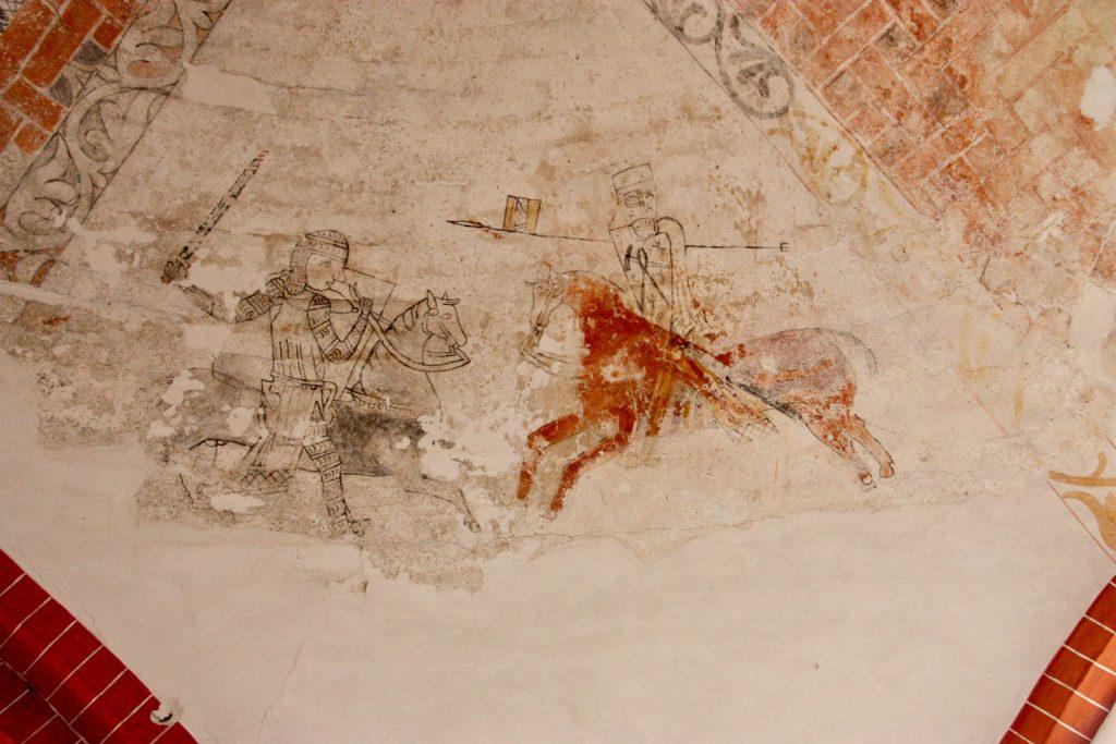Schilderingen van een gevechtsscone in de kerk van Den Andel